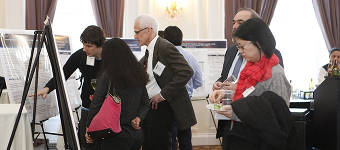 people standing at poster session